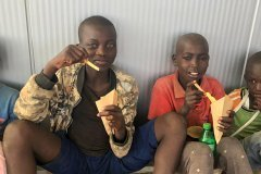 Kids enjoying their fresh chips after a joint road clean up